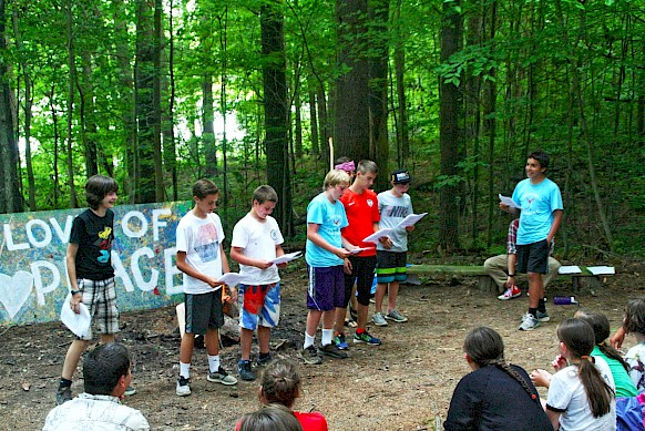 Javier and his boys perform an original skit at camp