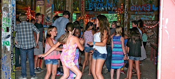 Erica has her whole cabin dancing it up in the barn!
